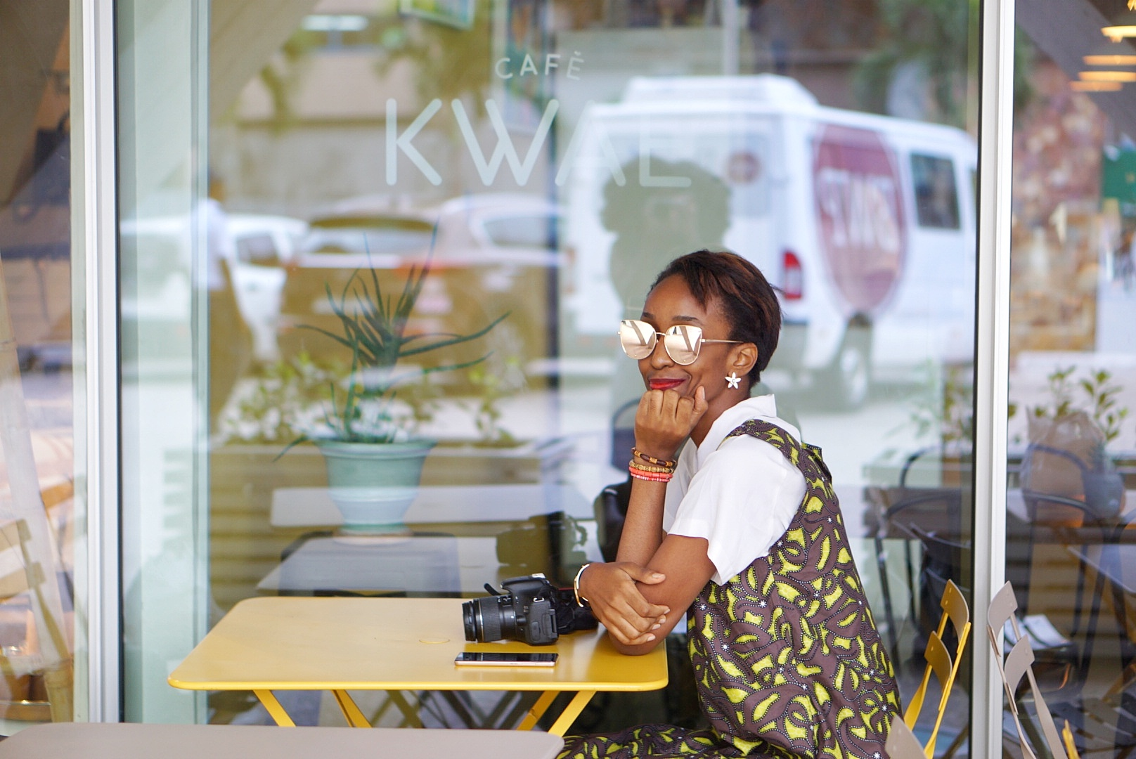 Nigerian Fashion and lifestyle blogger Cassie Daves sitting outdoor at Cafe Kwae in Accra, Ghana
