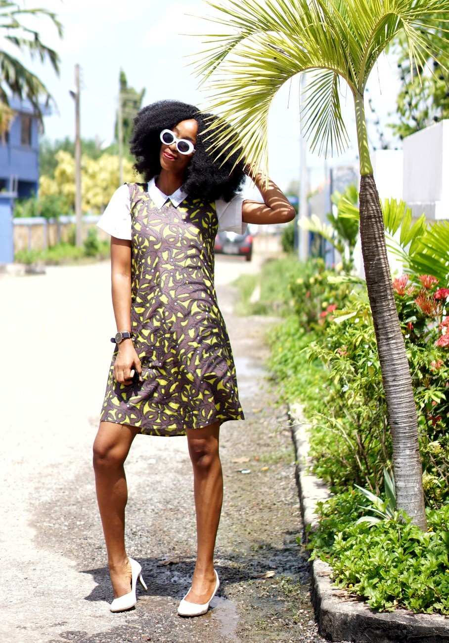 Nigeria fashion blogger Cassie daves in sleeveless ankara shift dress