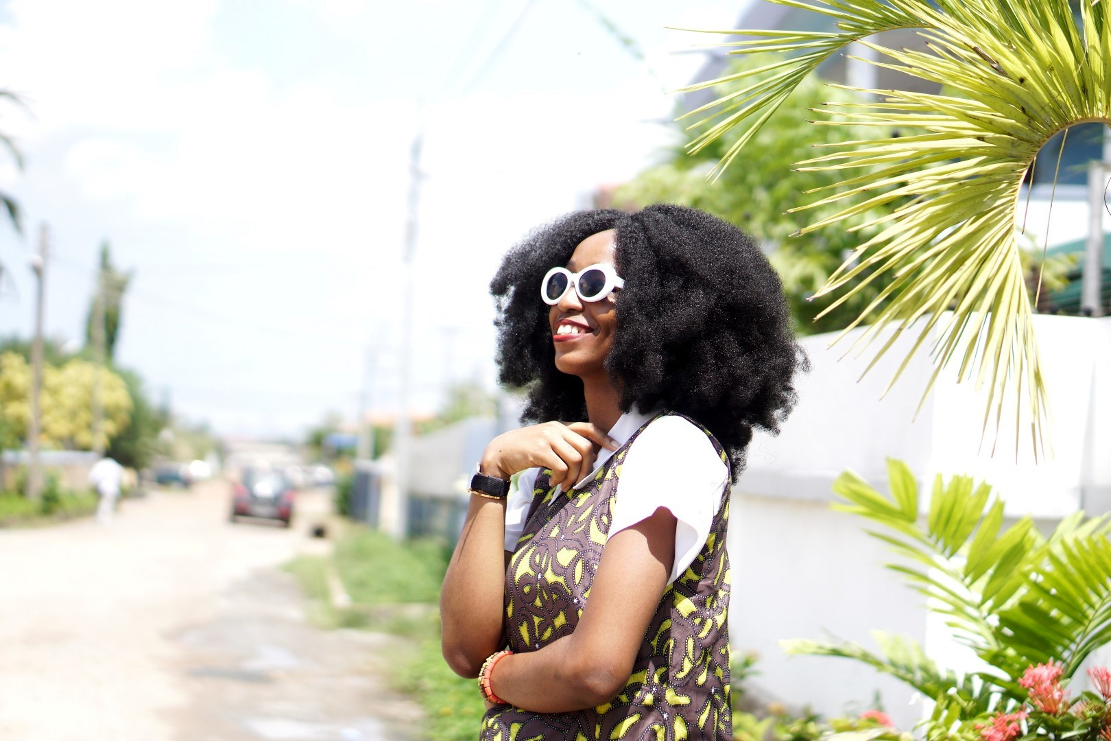 Nigeria fashion blogger Cassie daves in white sunglasses Kurt cobain and afro crochet wig by nappy haired wigs.