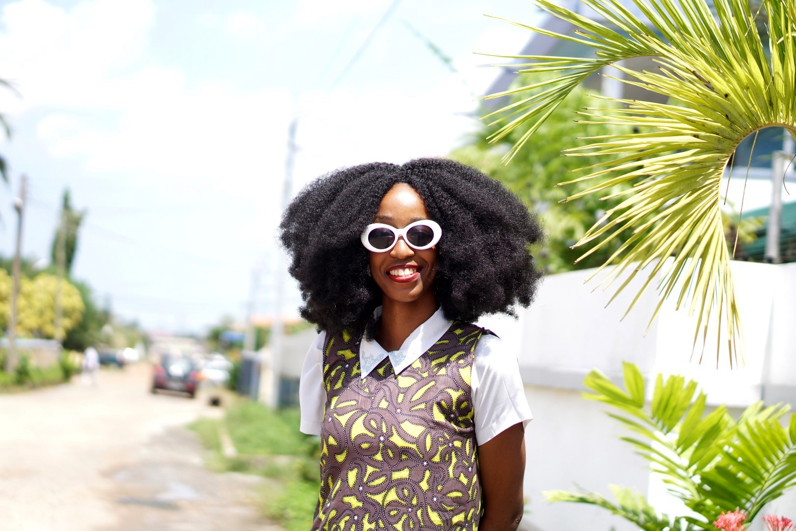 fashion blogger Cassie daves in Kurt cobain white sunglasses and afro wig by nappy haired wigs