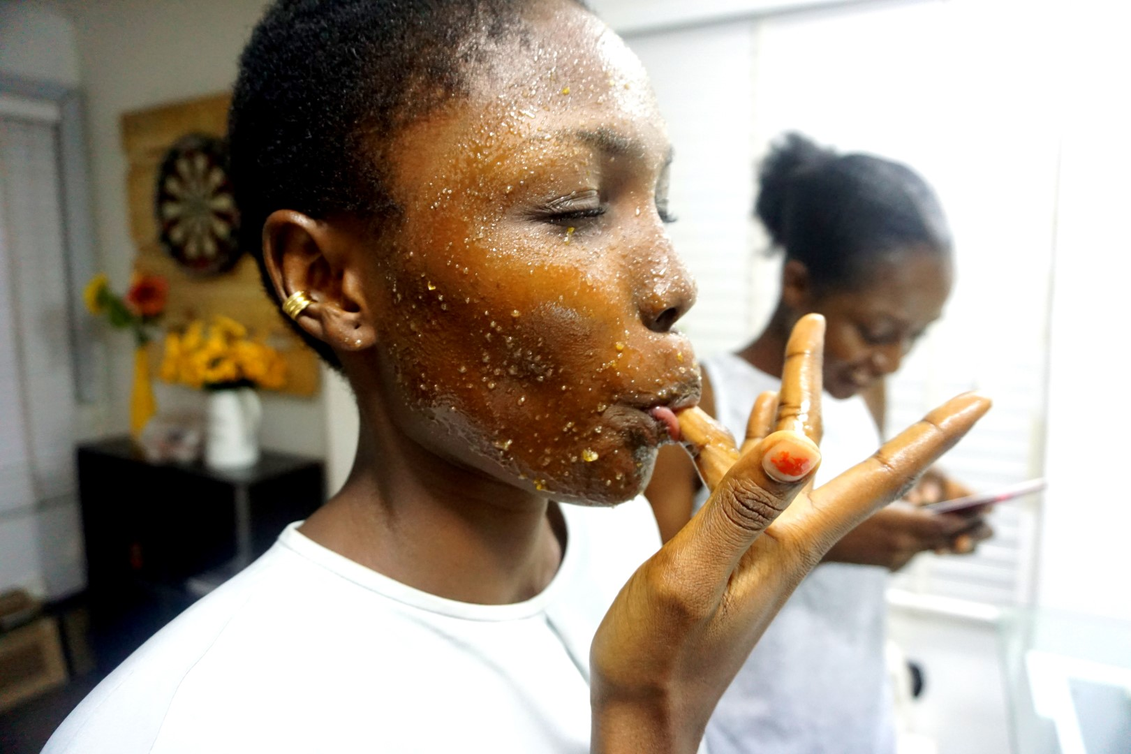 black model using DIY brown sugar face scrub