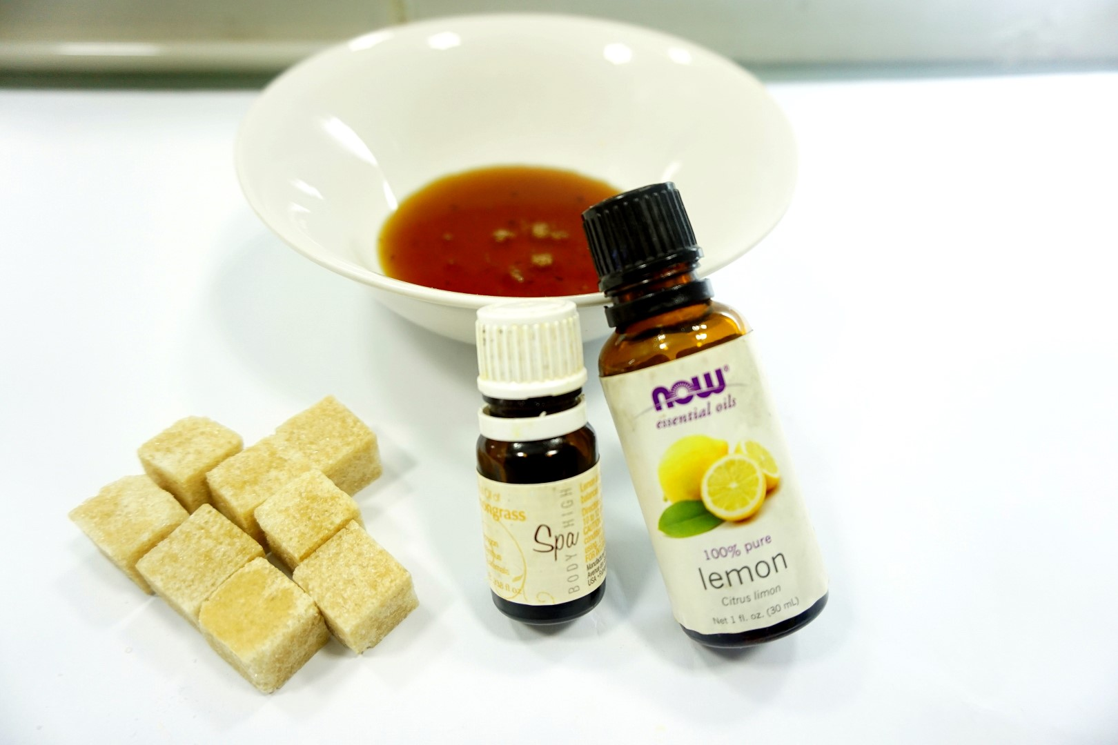 Essential oils, honey and brown sugar for homemade face mask and scrub