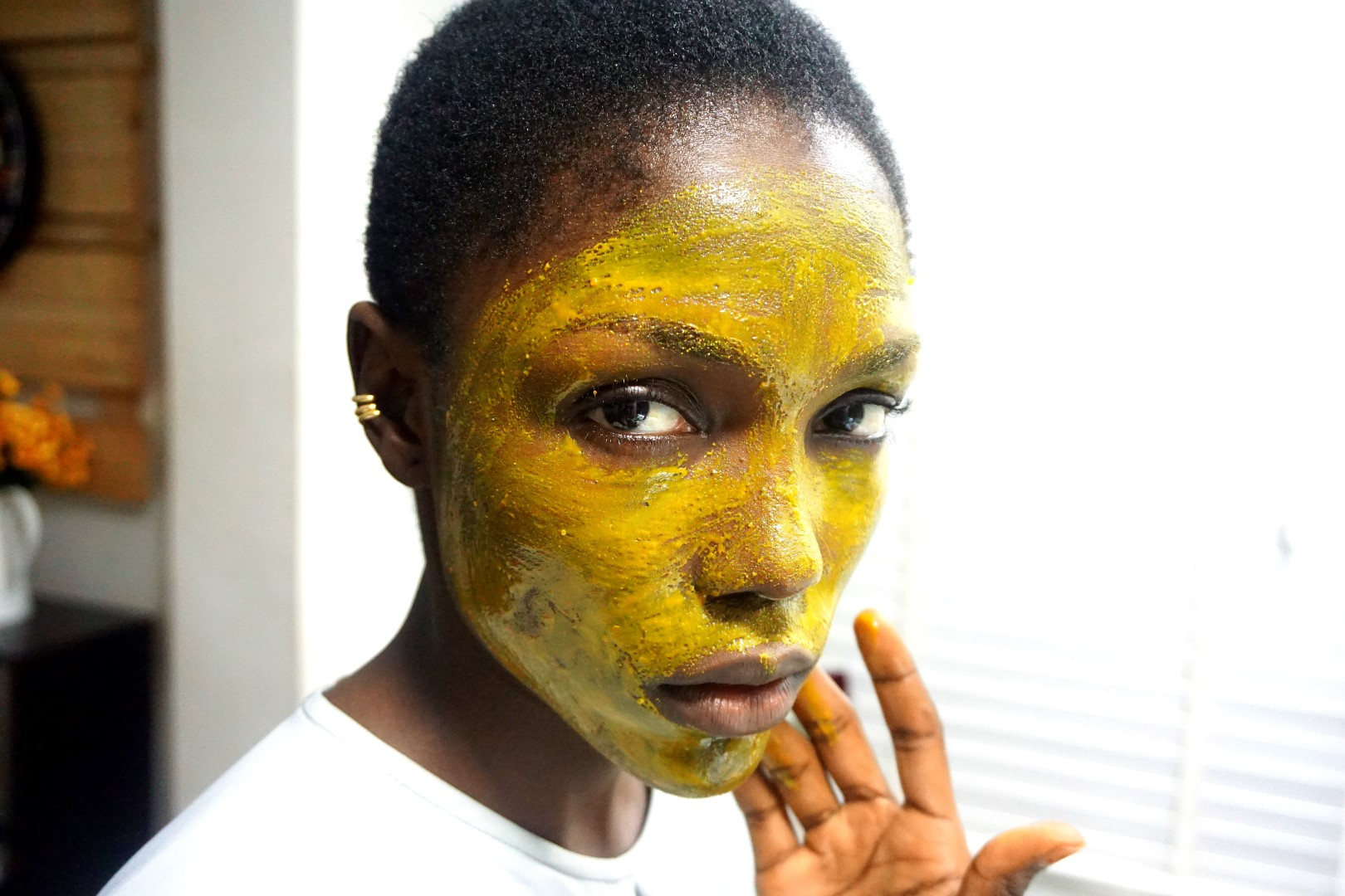 black model using DIY turmeric face mask