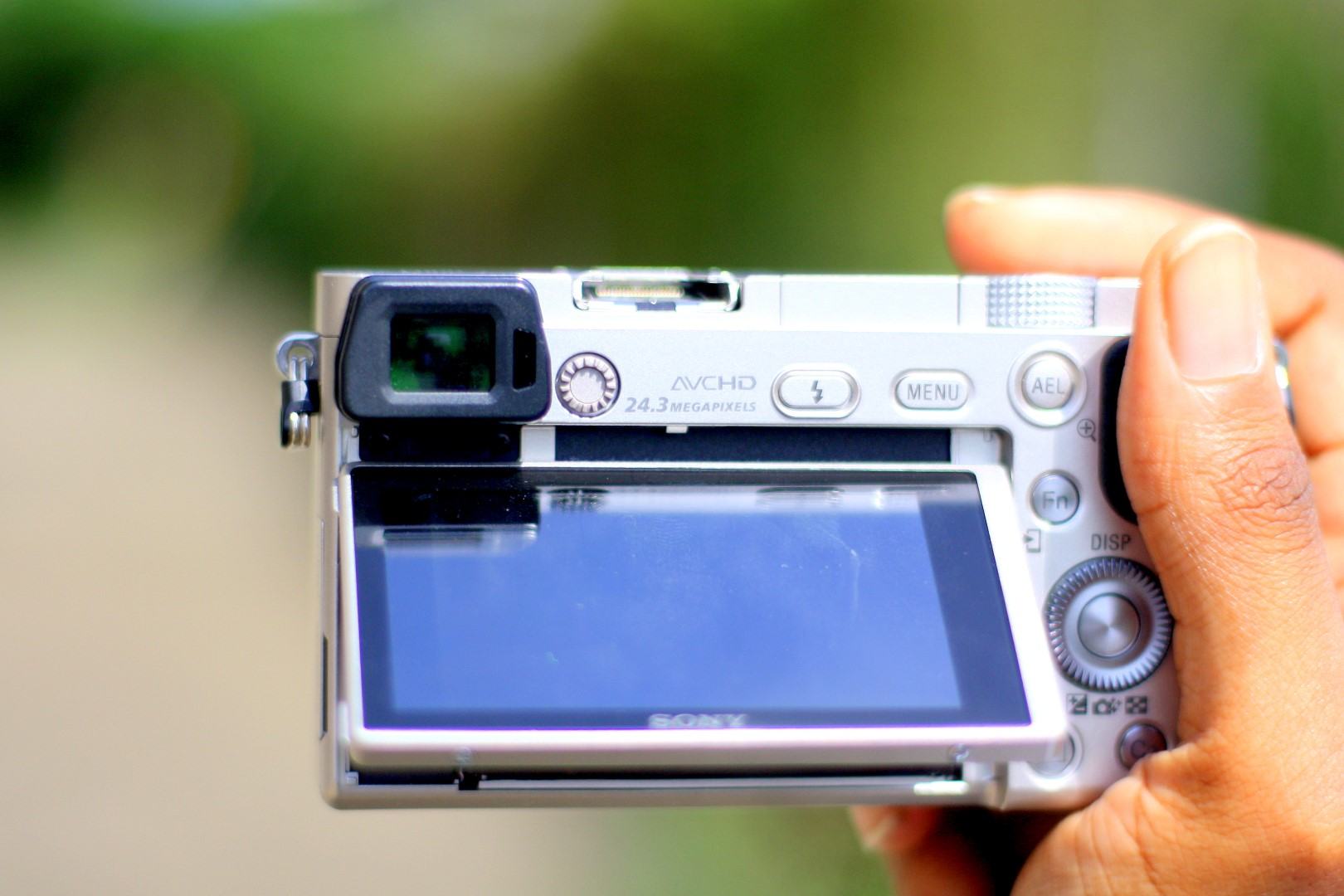 Sony Alpha A6000 front view showing tilted LCD Screen