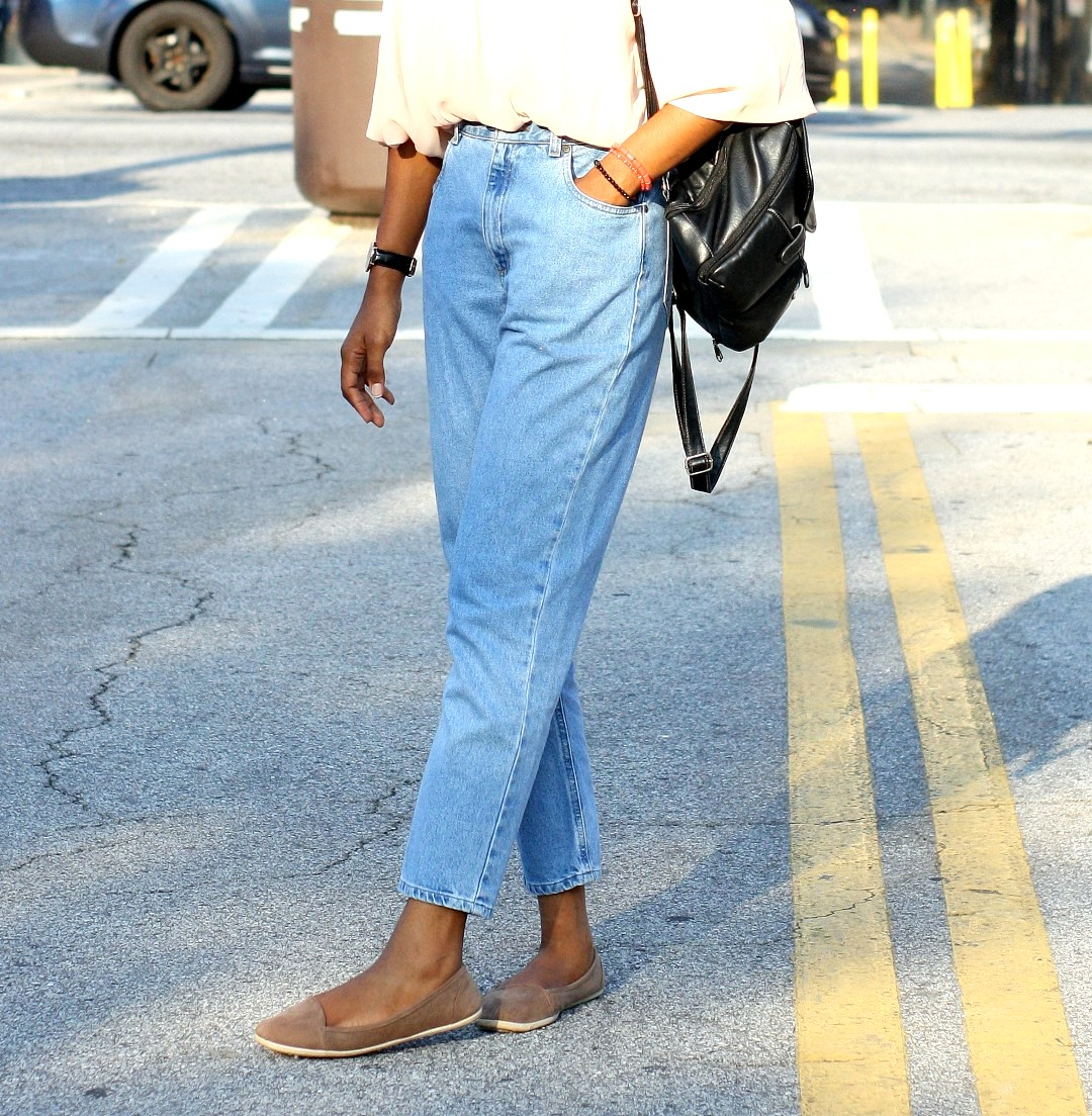 Wardrobe essentials - Nigerian fashion blogger Cassie Daves wearing a light blue mom jeans and brown flats
