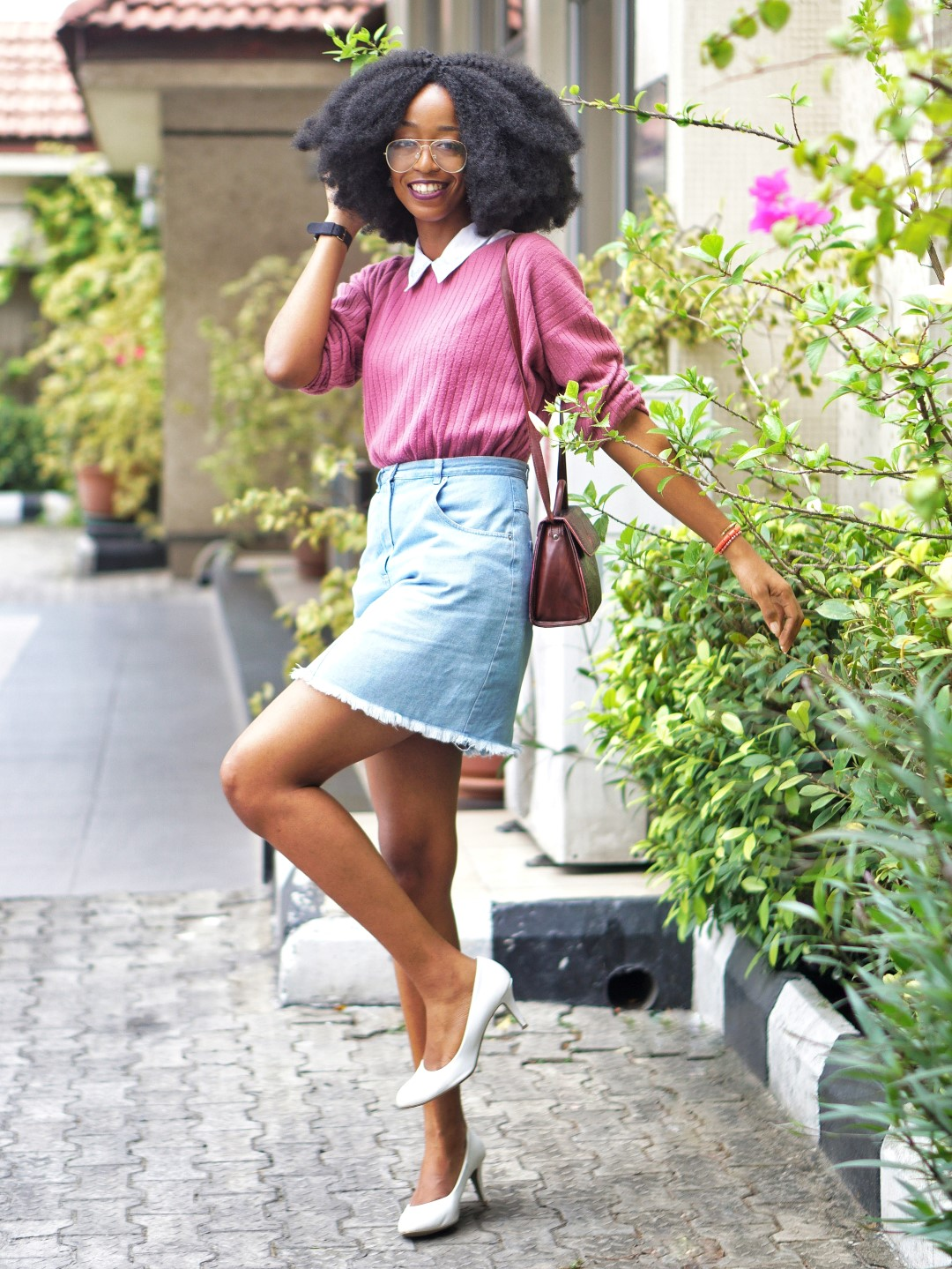 nigerian fashion blogger Cassie daves wearing a denim mini skirt, and white court shoes