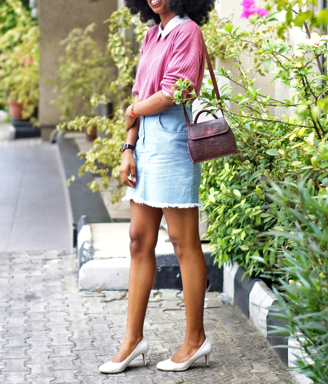 nigerian fashion and lifestyle blogger Cassie daves wearing a denim mini skirt, and white court shoes