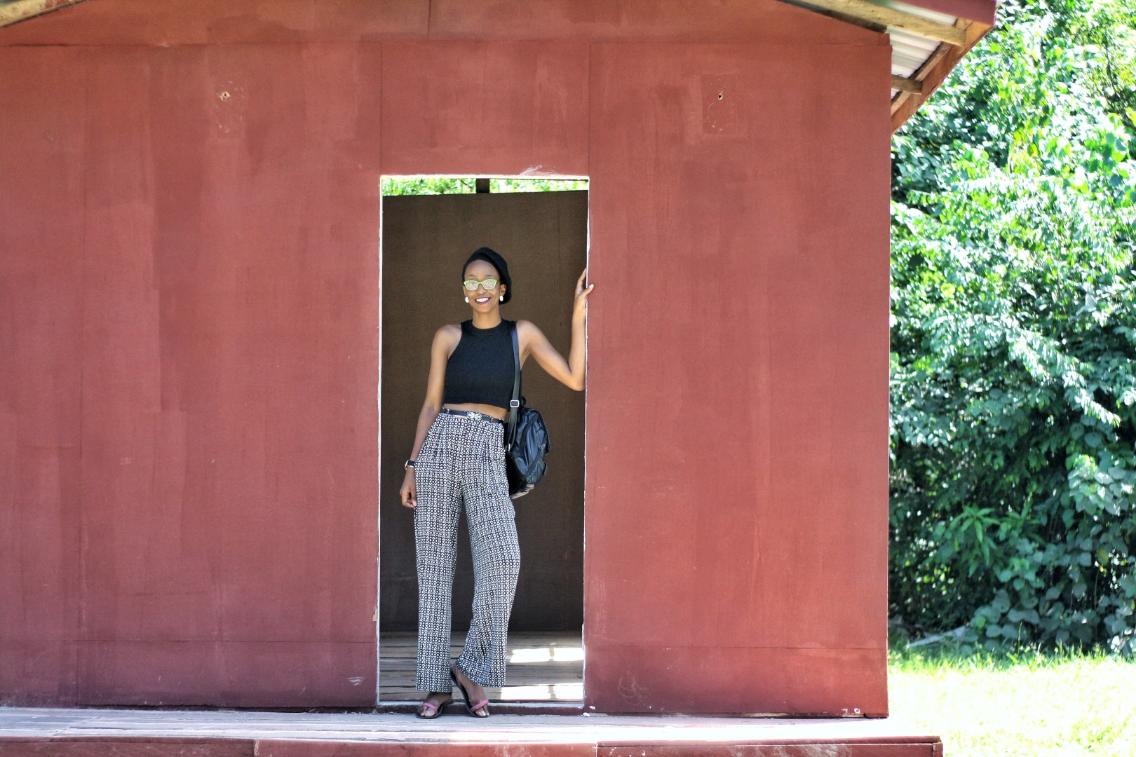 Nigerian fashion blogger Cassie Daves standing at the entrance of an uncompleted building at the lufasi park
