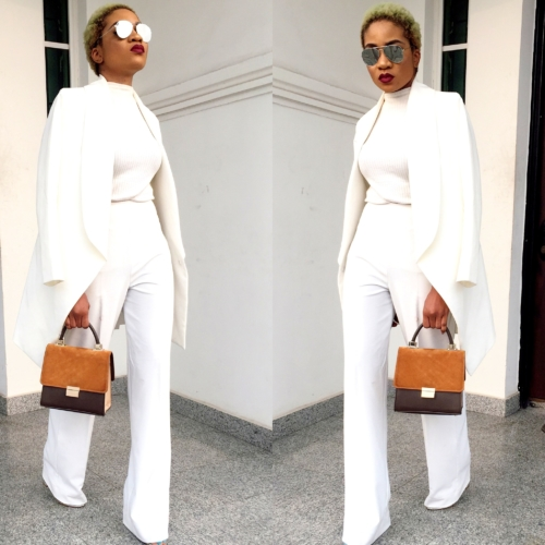 Nigerian fashion girl jennifer oseh, theladyvhodka in a gold two piece white suit and mirror sunshades