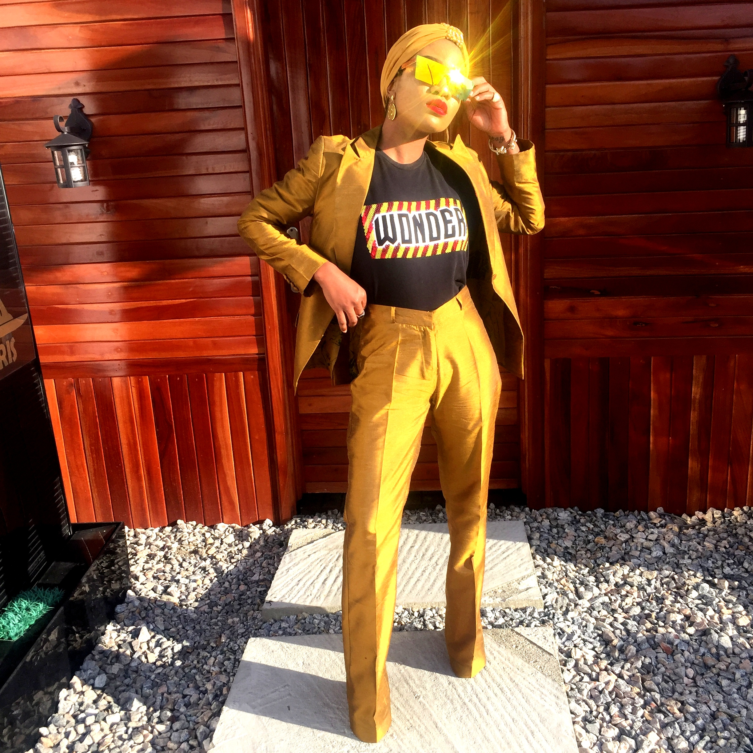 Nigerian fashionista jennifer oseh, theladyvhodka in a gold two piece metallic suit and mirror sunshades