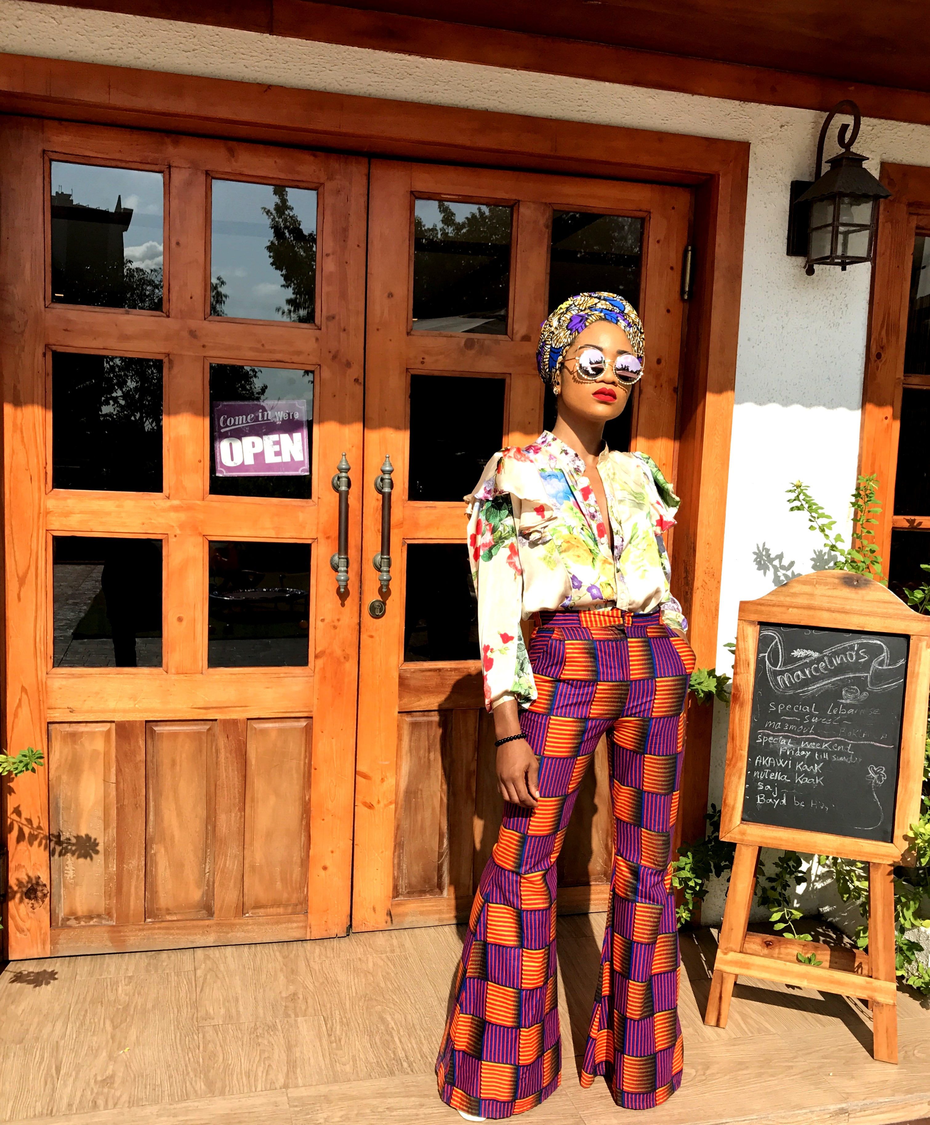 Nigerian fashionista jennifer oseh, theladyvhodka in ankara mixed prints and turban outfit