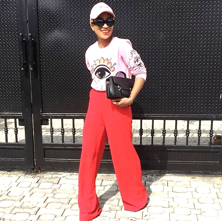Nigerian fashionista jennifer oseh, theladyvhodka in red flared pants and a pink sweat shirt