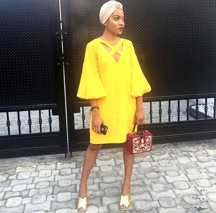 Nigerian fashionista jennifer oseh, theladyvhodka in a yellow shift dress and turban
