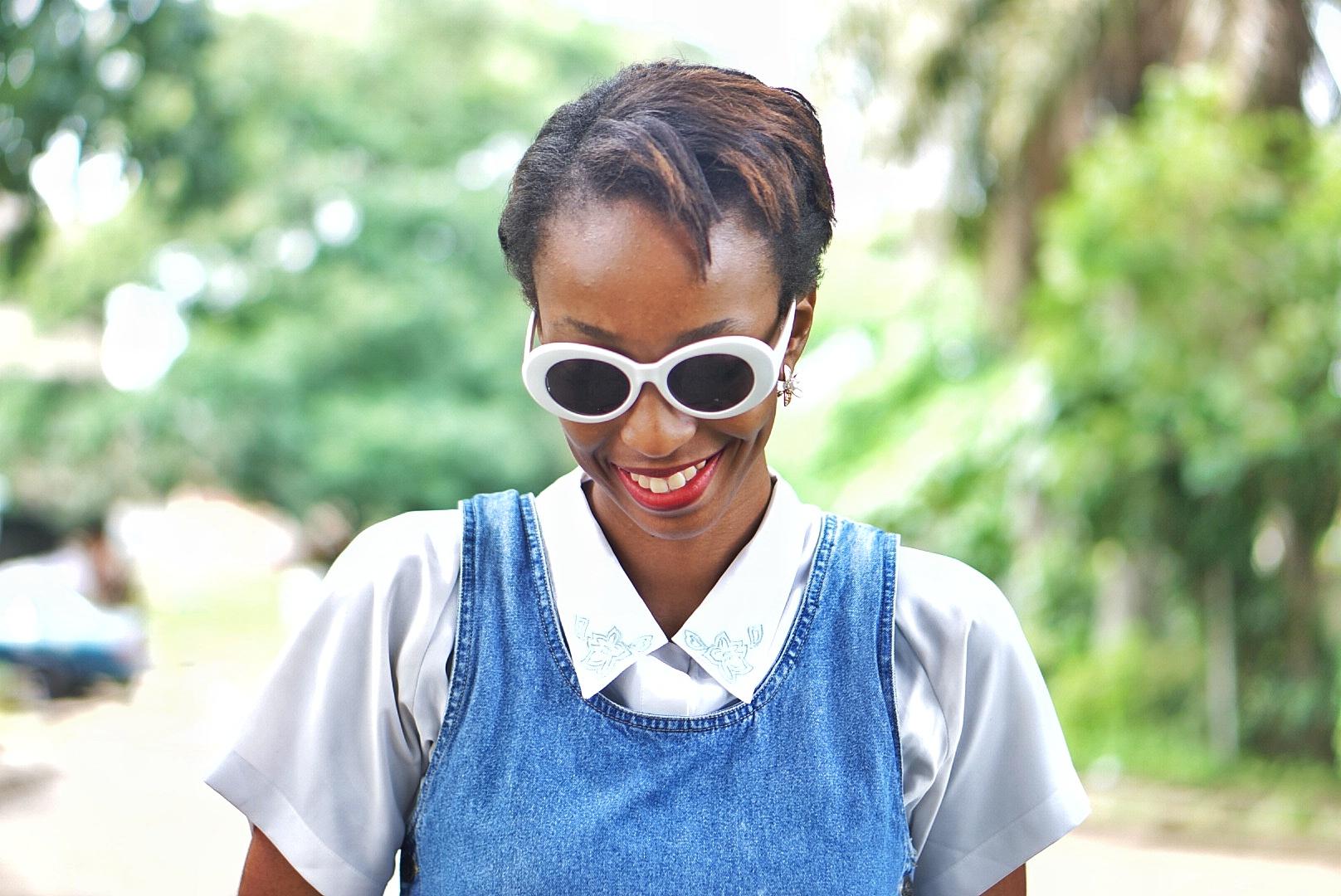 Nigerian fashion blogger Cassie Daves smiling with kurt cobain sunshades on