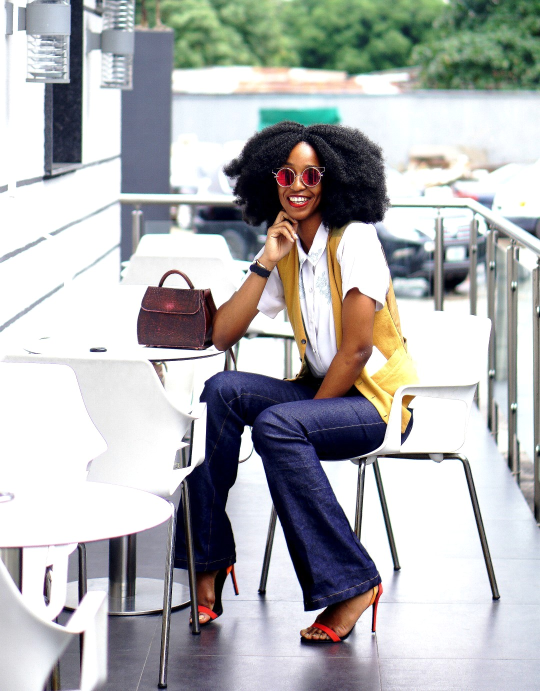 Nigerian lifestyle blogger Cassie Daves in high waisted flare jeans