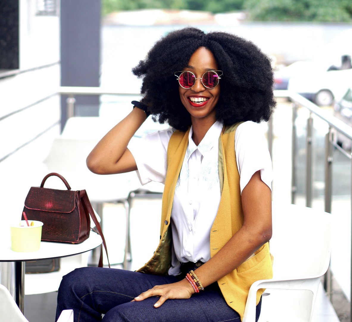 Nigerian Fashion blogger Cassie Daves sitting at Hans and Rene, a gelato shop in Lagos Nigeria