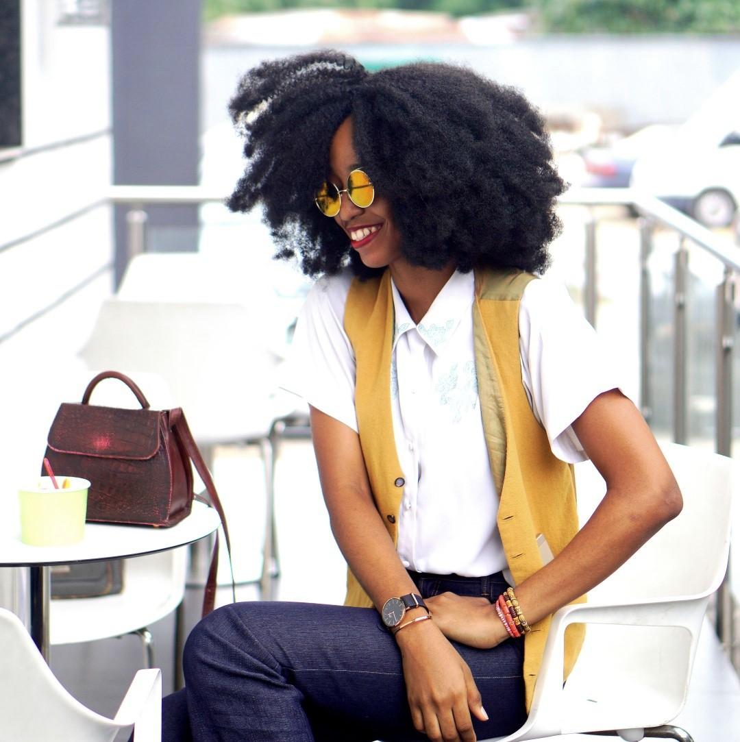 Nigerian Fashion blogger Cassie Daves sitting at a gelato shop in Lagos Nigeria