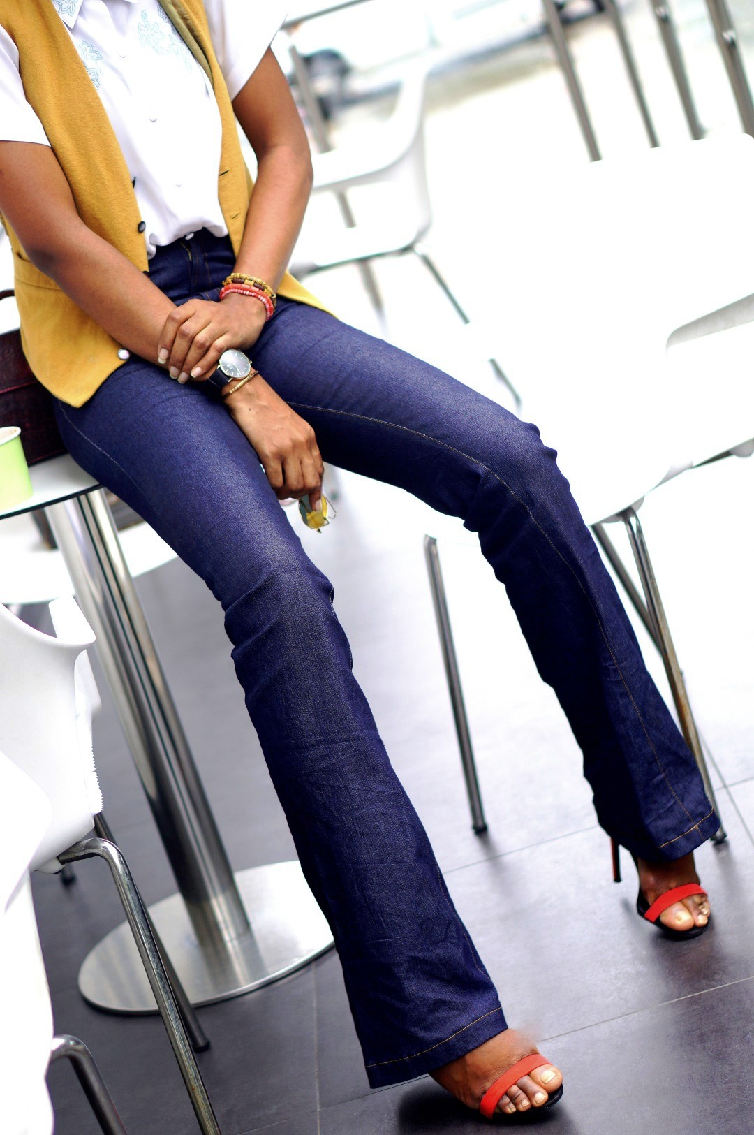 Nigerian Fashion blogger Cassie Daves in a high waisted flare jeans