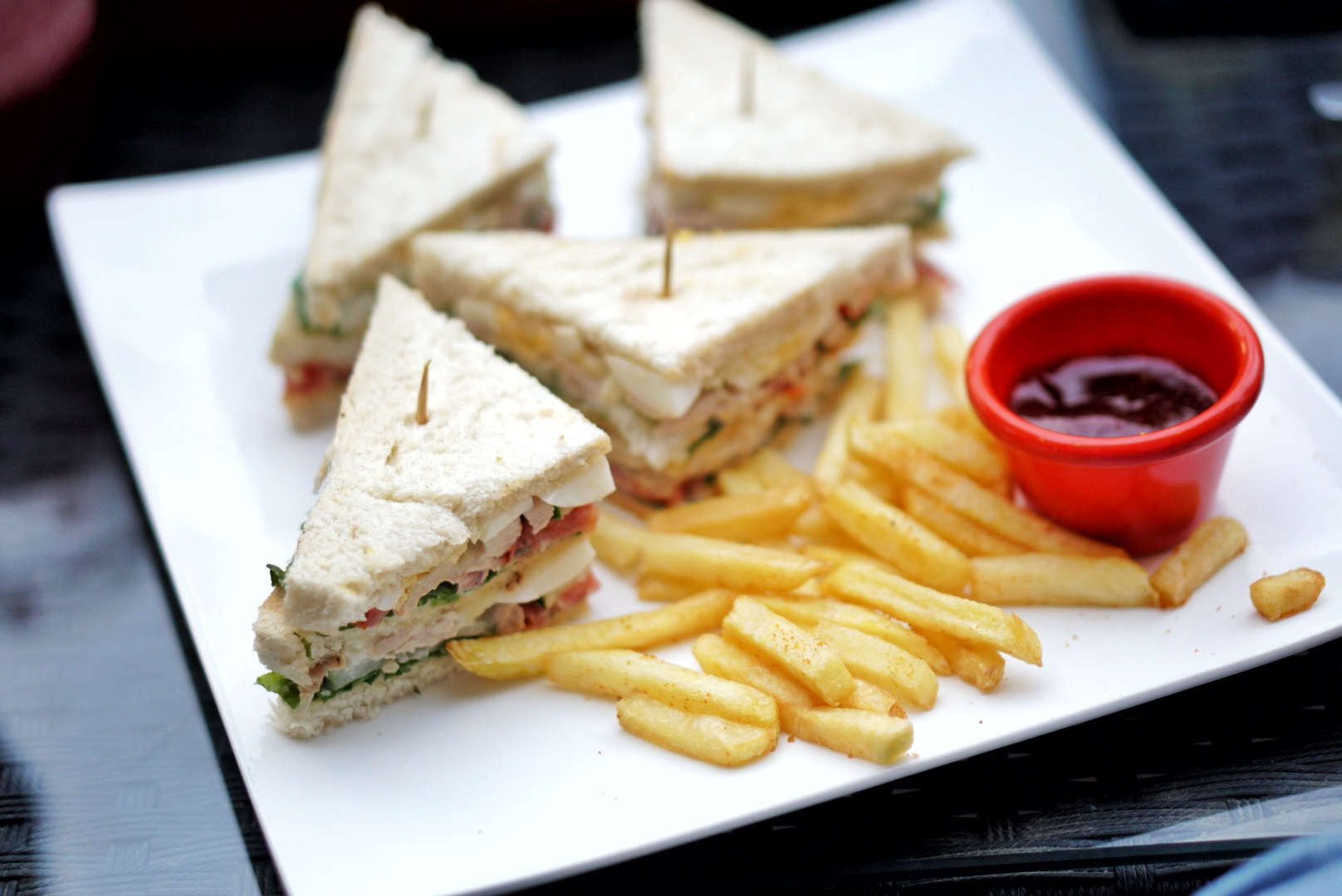 Club sandwich and fries at samantha's bistro