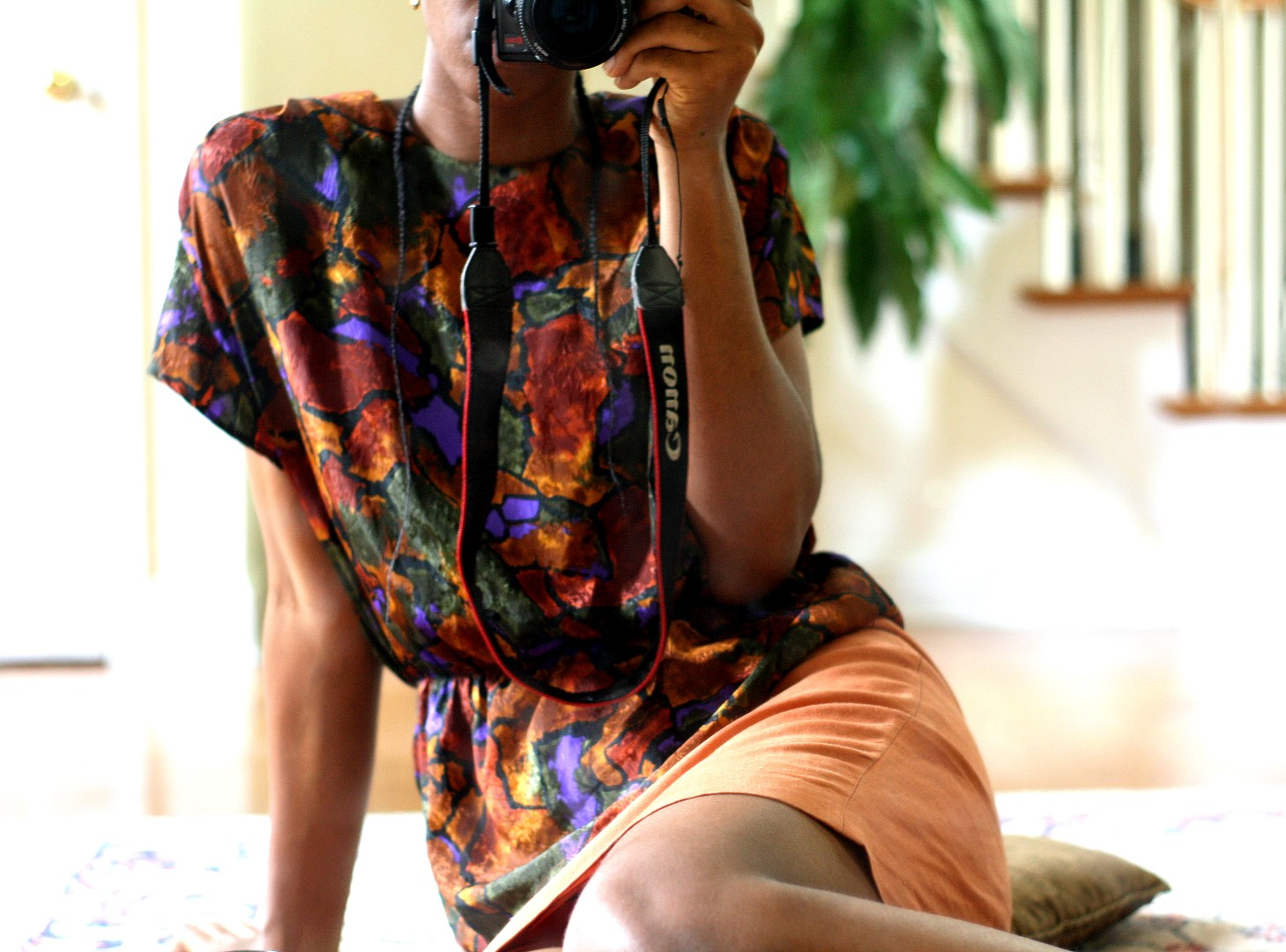 Going back to the basics - Nigerian fashion blogger Cassie Daves wearing a bright colored prints top