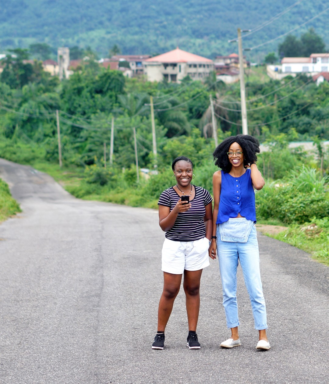 Nigerian Fashion blogger Cassie Daves and a friend at Erin Ijesha waterfall