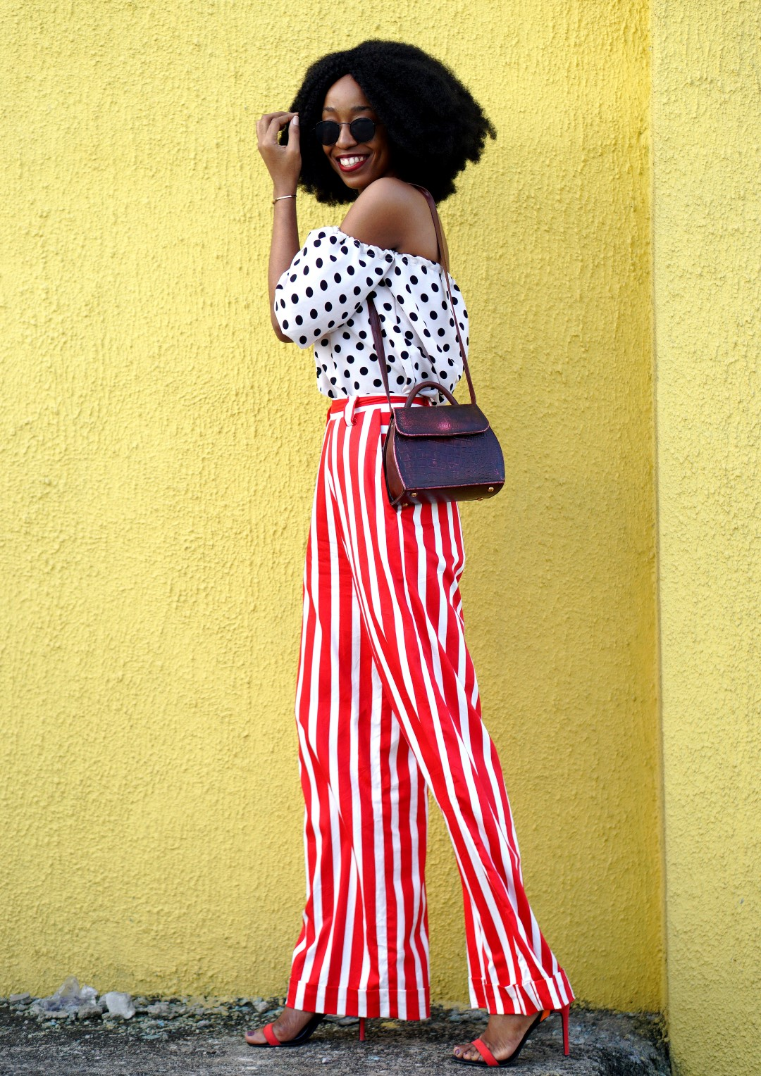 Mixed prints fashion trend : Blogger Cassie Daves In a polka dot off shoulder top and striped pants
