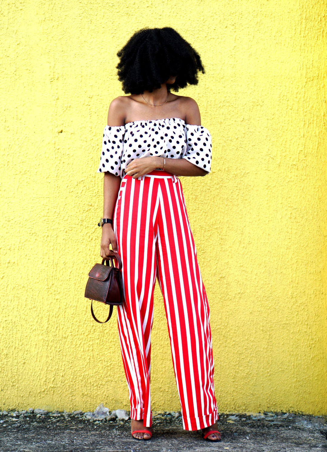 Mixed prints fashion trend : Nigerian blogger Cassie Daves In a polka dot off shoulder top and striped pants