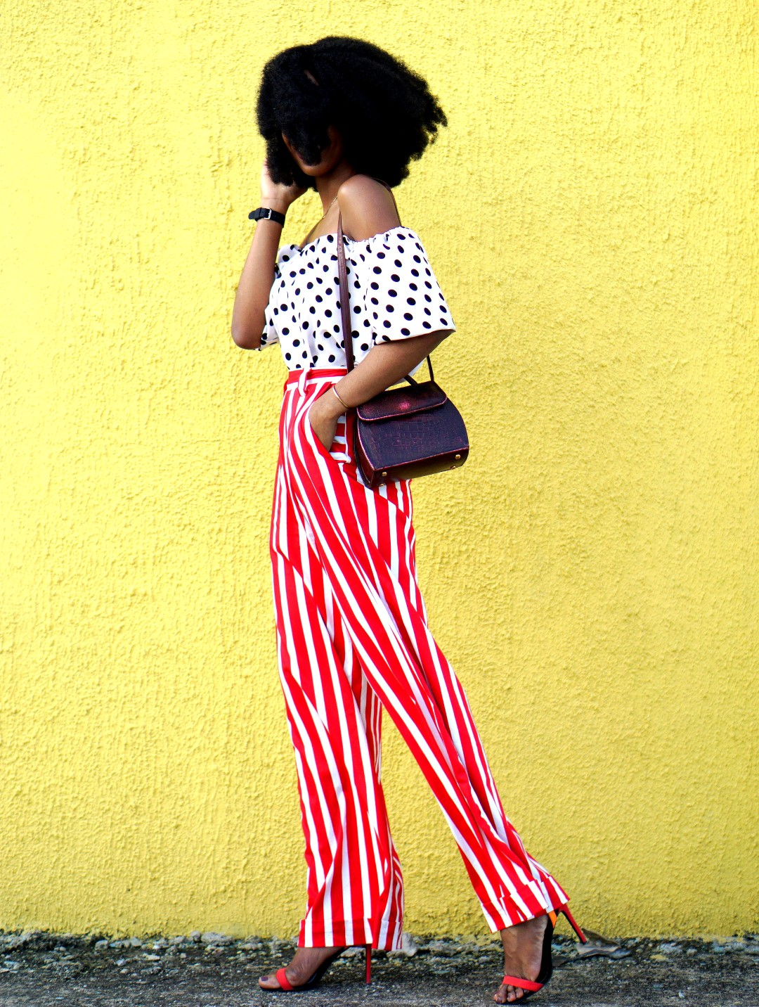 Mixed prints fashion trend : Nigerian fashion and lifestyle blogger Cassie Daves In a polka dot off shoulder top and striped pants