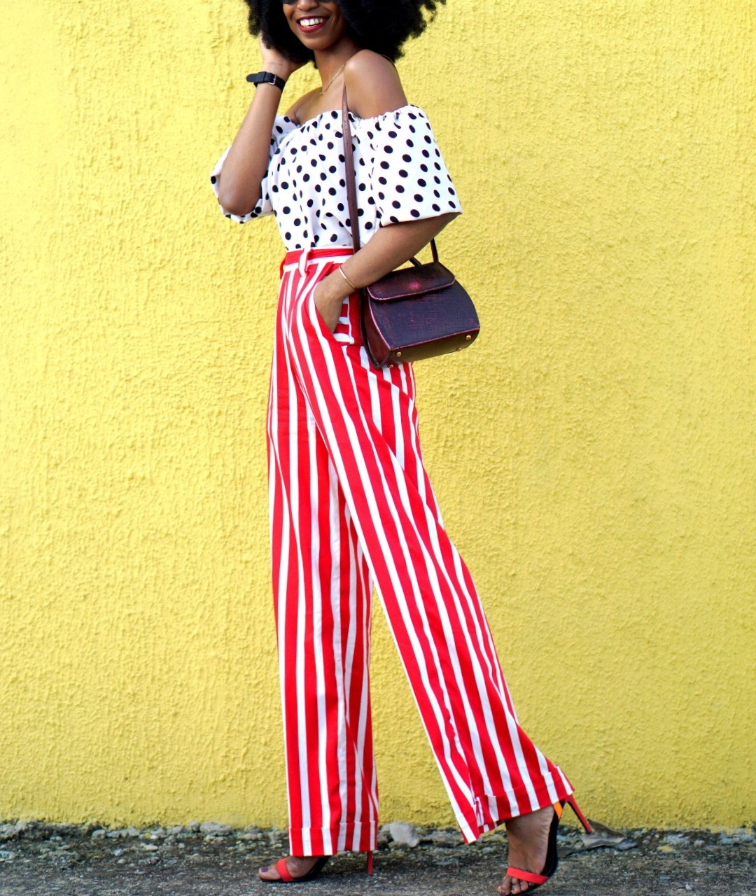 Mixed prints fashion trend : Nigerian fashion blogger Cassie Daves In a polka dot off shoulder top and striped pants