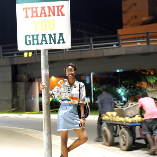 Nigerian blogger Cassie Daves standing at a sign post in Accra Ghana, Things to do In Accra