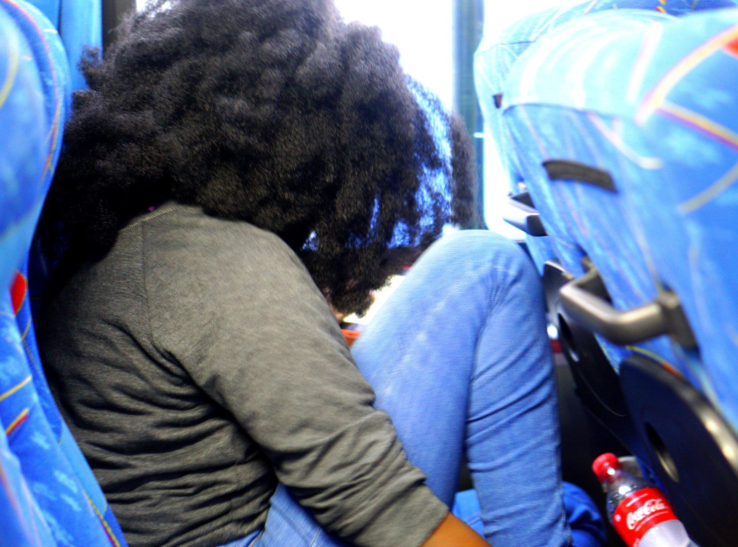 Nigerian Blogger Nappyhaired on a bus going from lagos to ghana by road