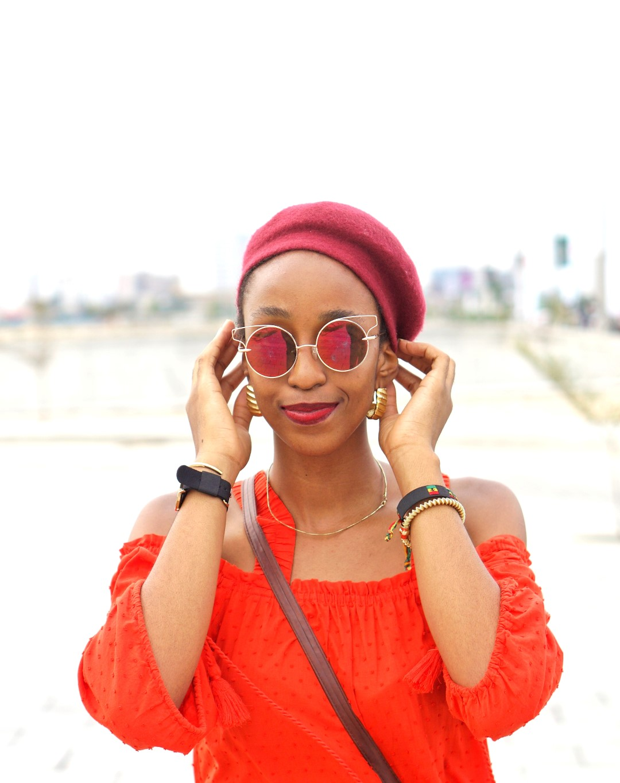 Nigerian blogger inwine red beret fashion trend