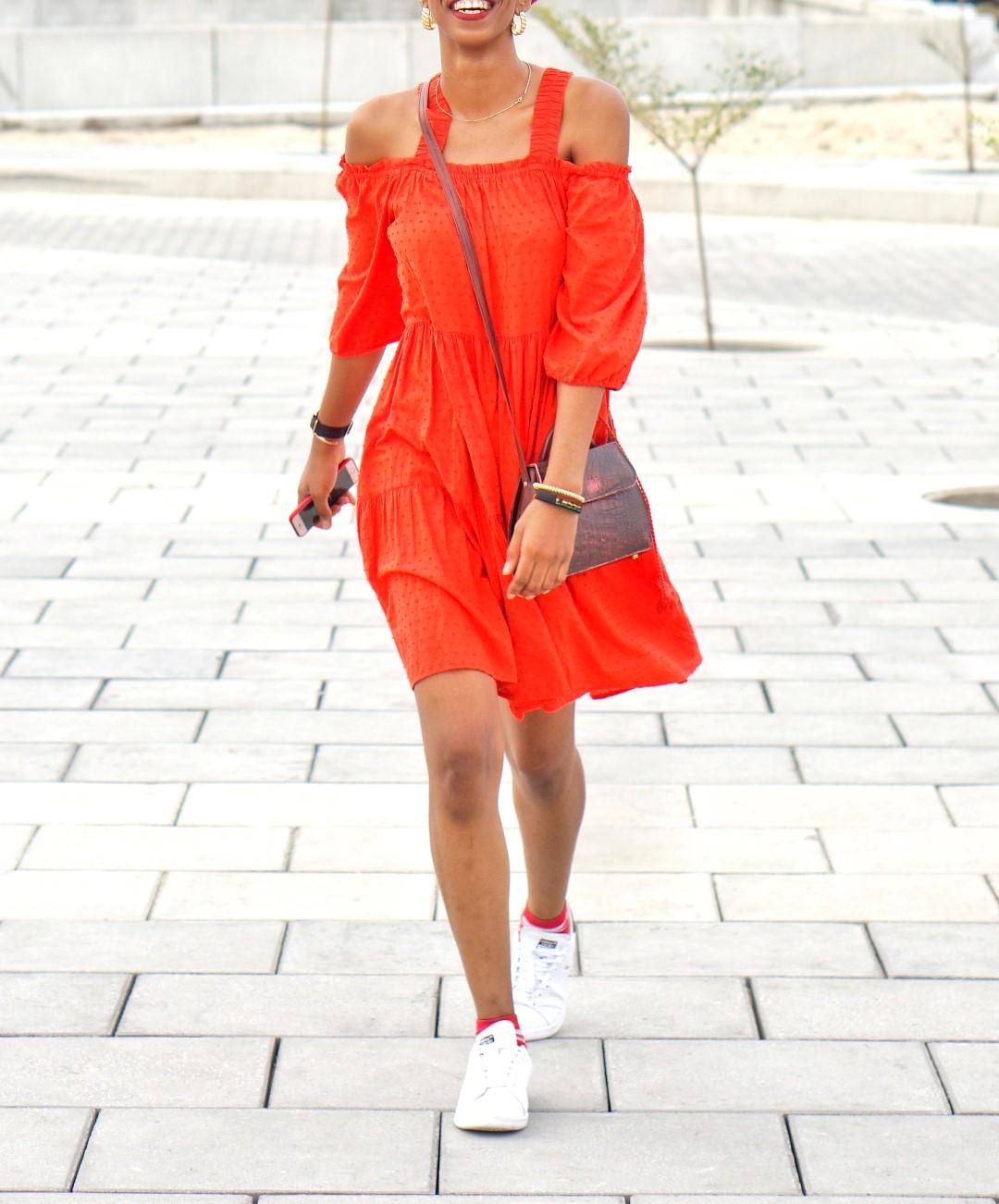 Nigerian blogger cassie daves wearing orange off shoulder h&m dress