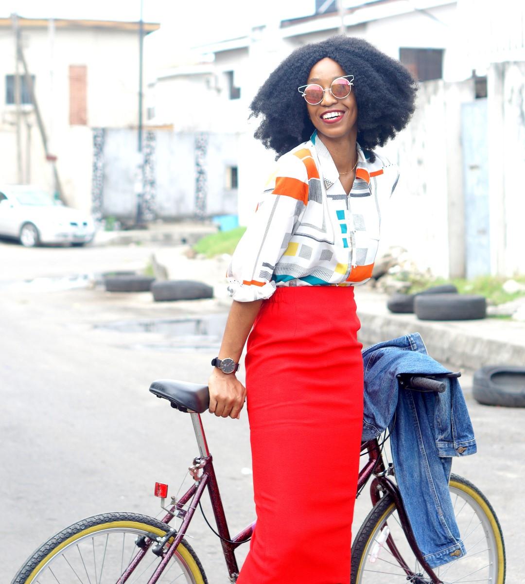 Nigerian blogger Cassie Daves in Red midi pencil skirt, vintage print shirt