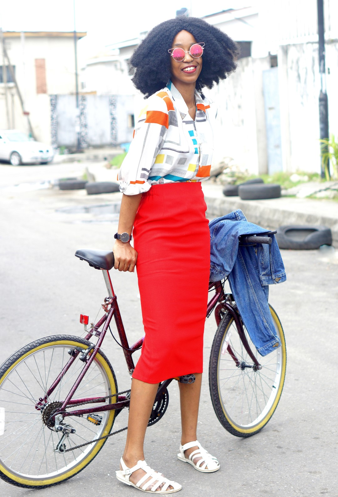 Nigerian fashion blogger Cassie Daves in Red midi pencil skirt, vintage print shirt and denim jacket