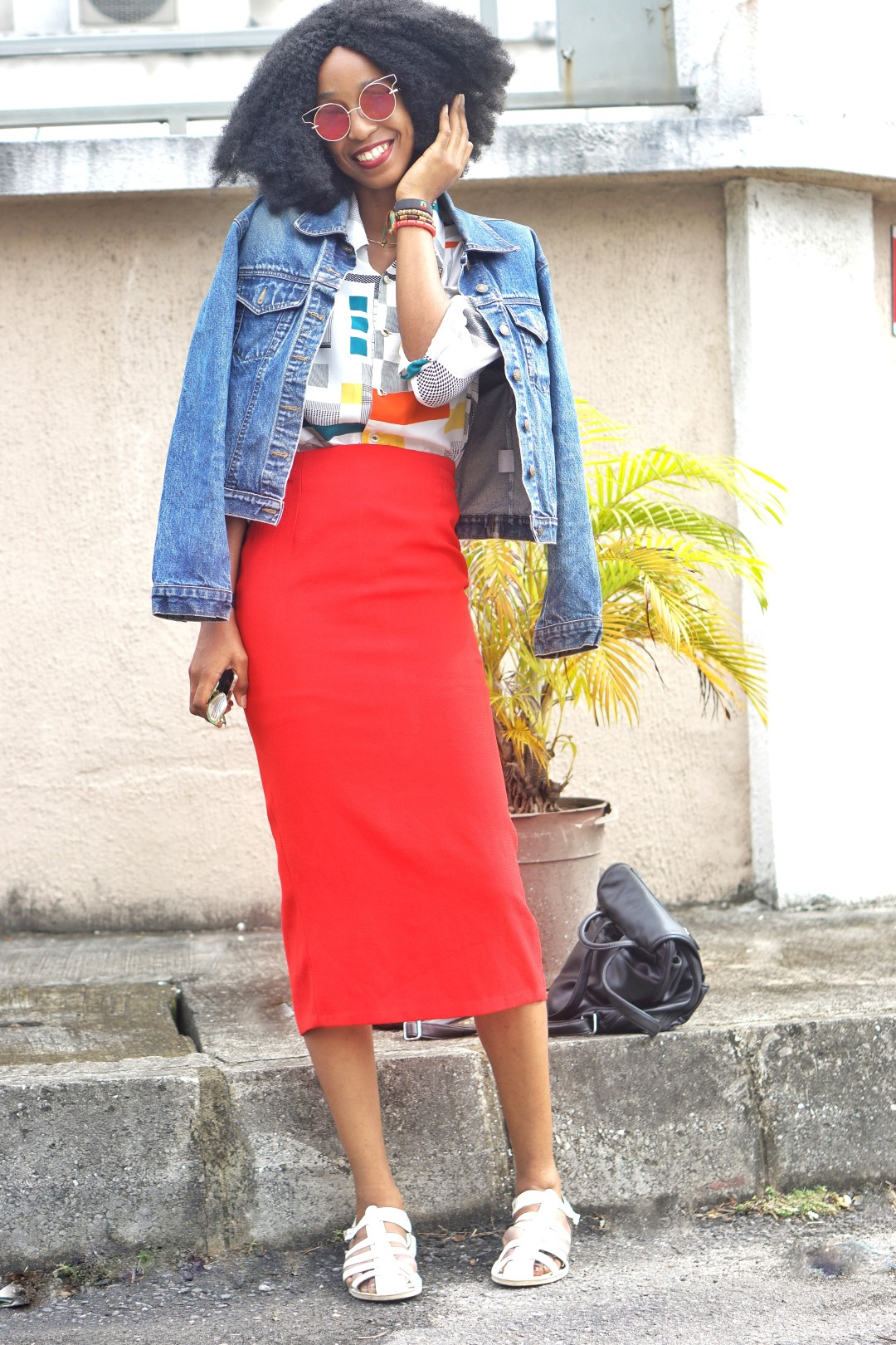 Cassie Daves in Red midi pencil skirt, vintage print shirt and denim jacket