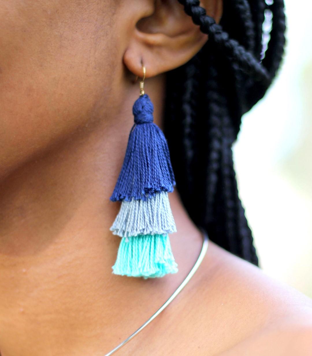 cassie daves wearing the tassel statement earrings