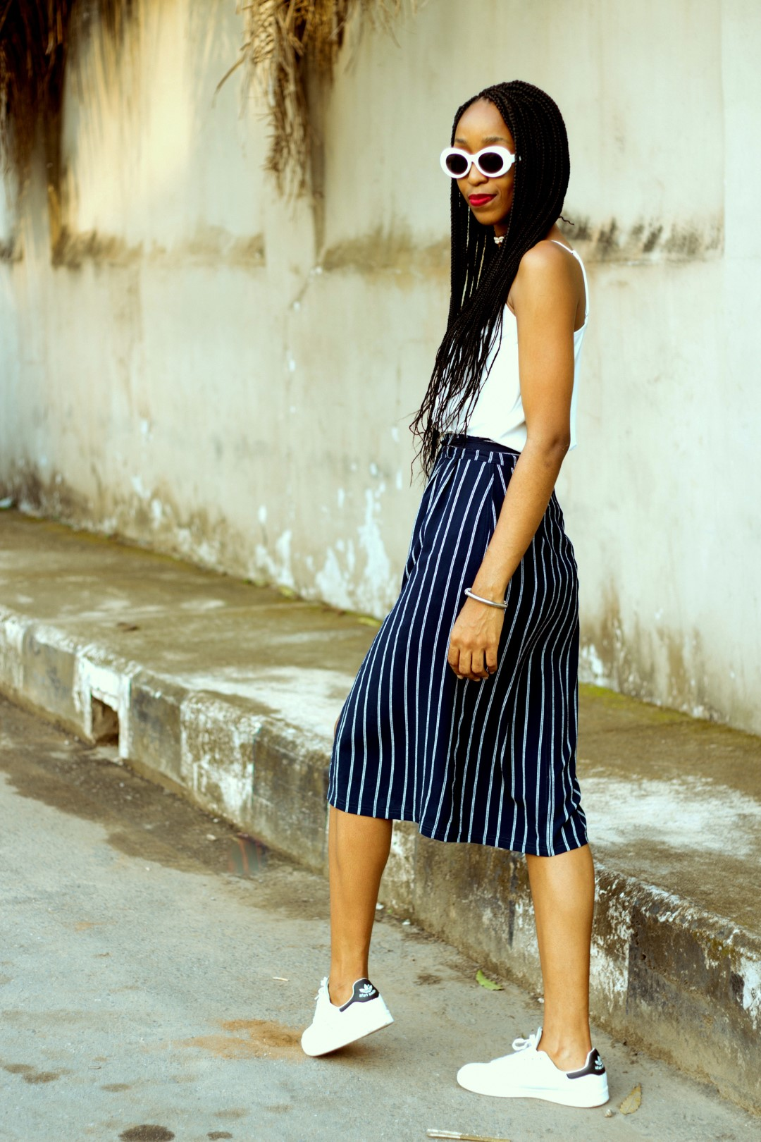 Nigerian blogger cassie daves styling the skirt and sneakers trend