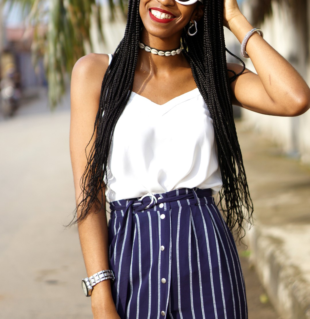 Nigerian blogger cassie daves in white camisole and button up skirt