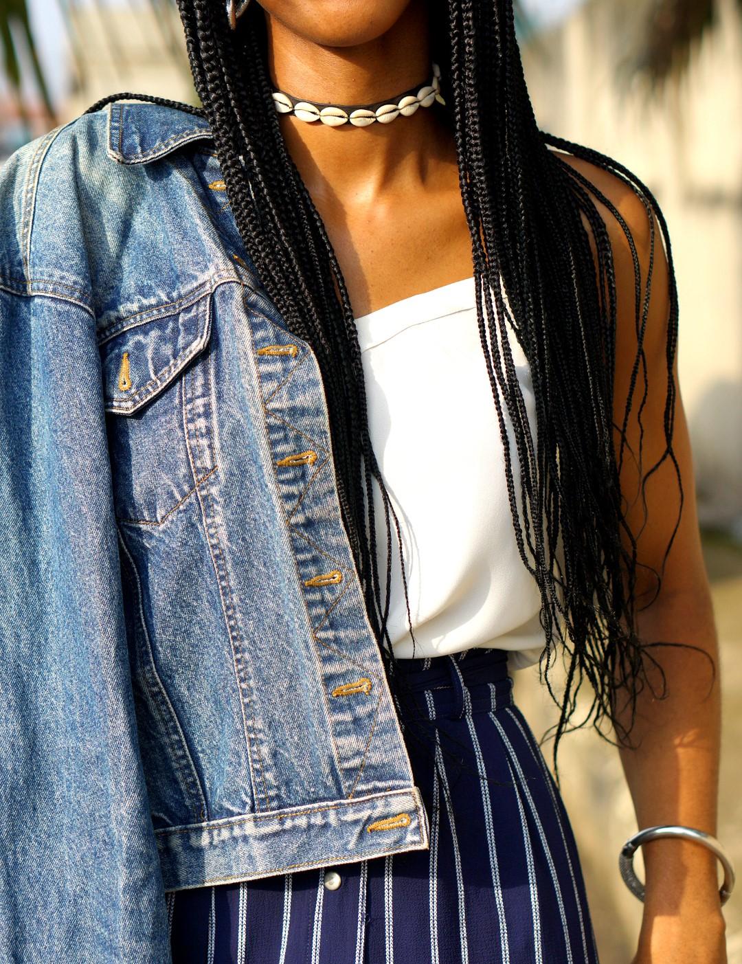 Nigerian blogger cassie daves in denim jacket and african inspired choker