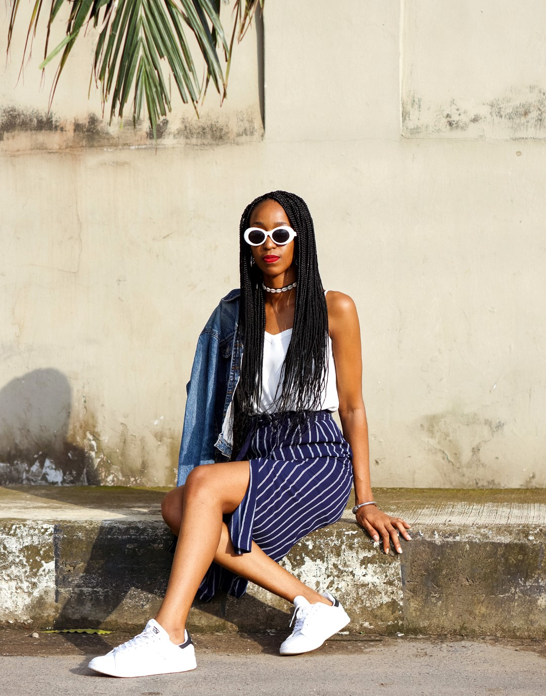 Lifestyle blogger cassie daves styling the skirt and sneakers trend