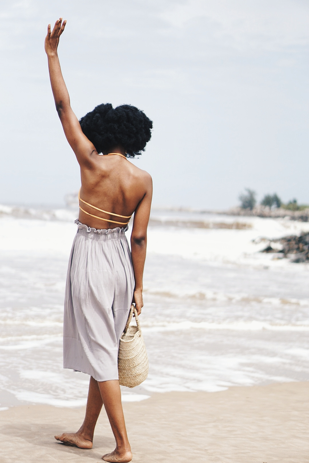 402e9317c4b ... Bikini alternative to swimsuit - Nigerian Lifestyle blogger Cassie  Daves with hands in the air at