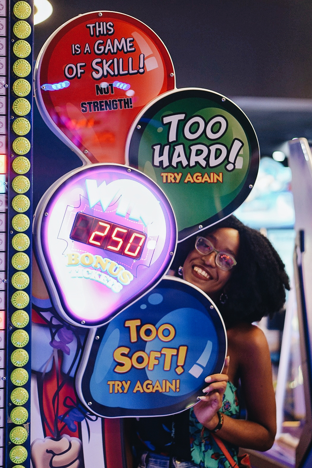 """86baeb2c1ba4 ... Cassie Daves holding games sign at rufus and bee games arcade in lagos.  """""""