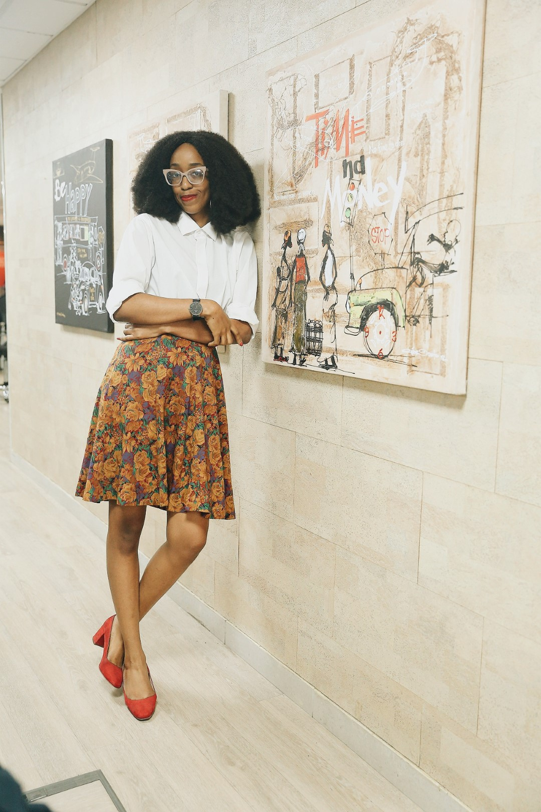 work style essential -Cassie Daves wearing a white shirt and floral skirt