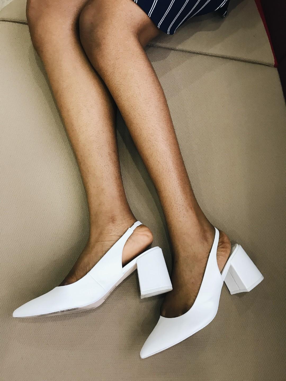 Cassie Daves wearing white blocked heels