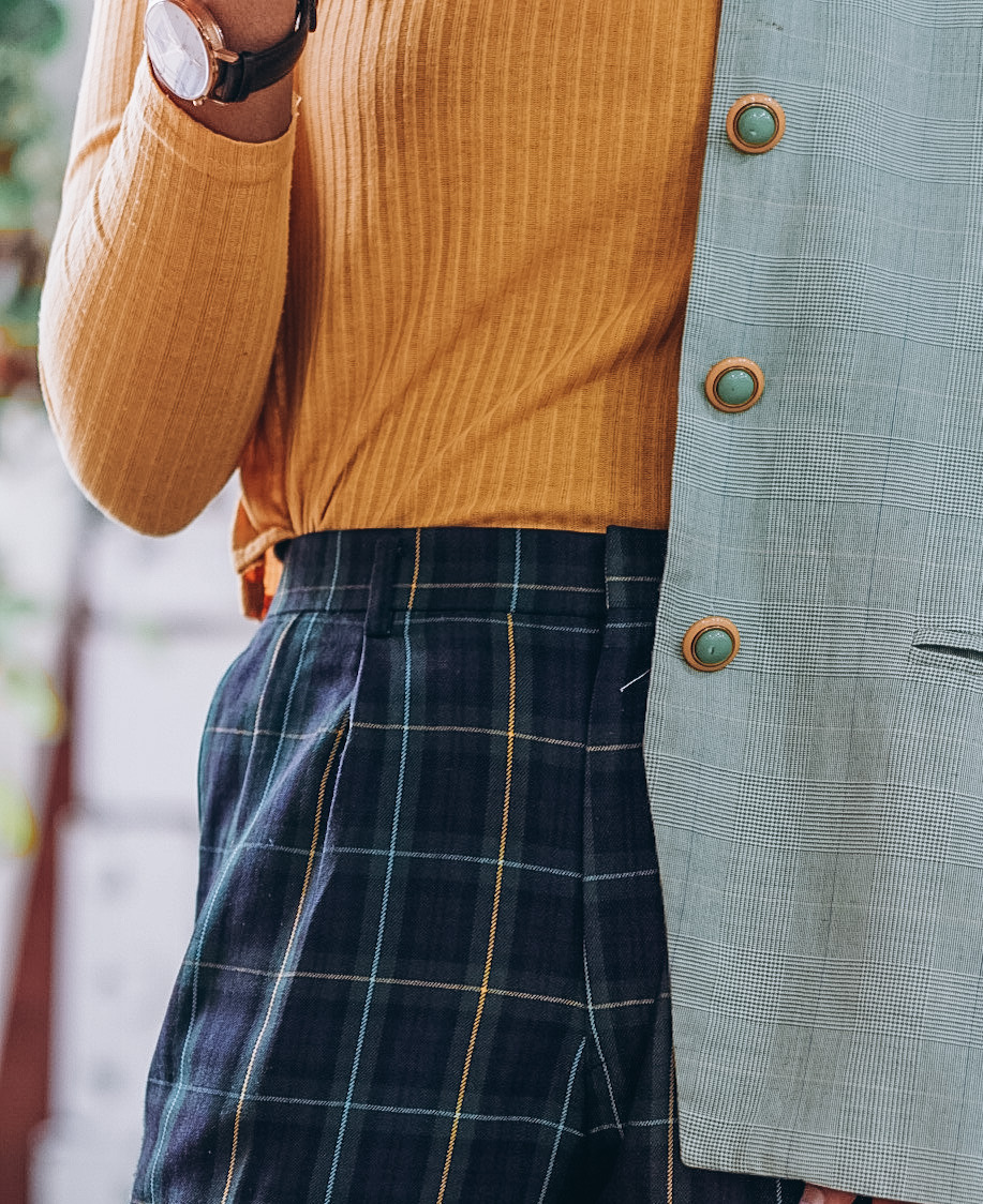 Wearing plaid oversized blazer,  turtle neck and plaid cropped pants