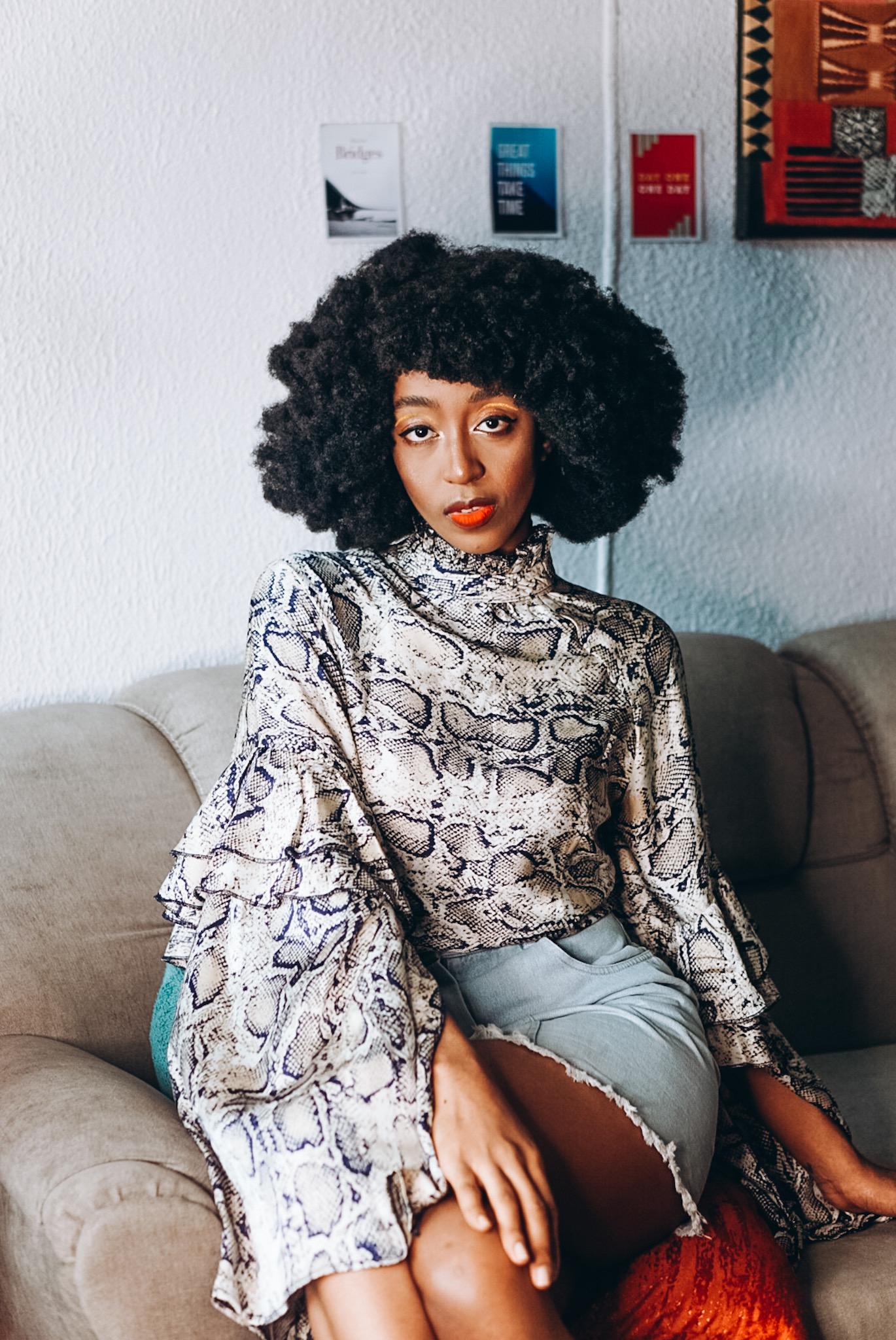 Nigerian style blogger Cassie Daves in a high neck shirt by Designer Rekana